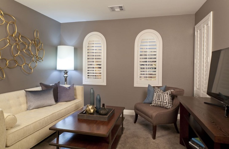 Orlando family room with rounded plantation shutters.