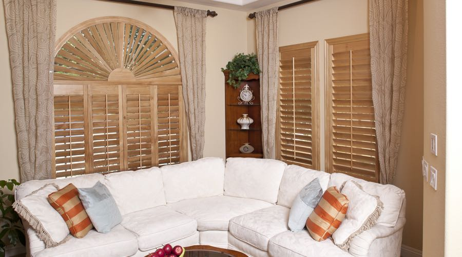 Sunburst Arch Ovation Wood Shutters In Orlando Living Room
