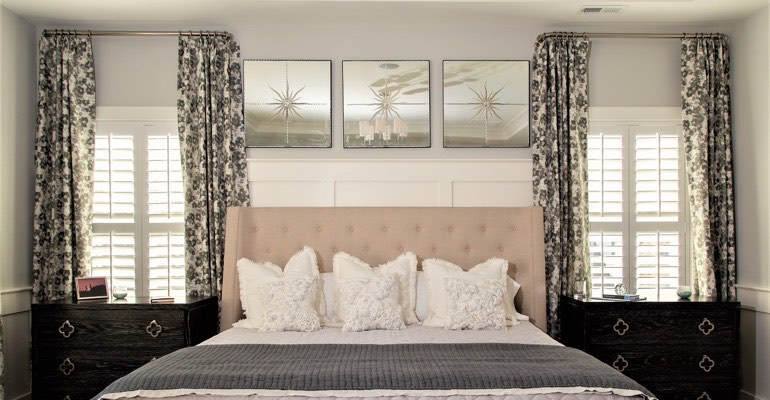 Luxury bedroom with plantation shutters.
