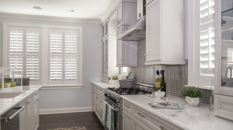Plantation shutters in Orlando kitchen with modern appliances.
