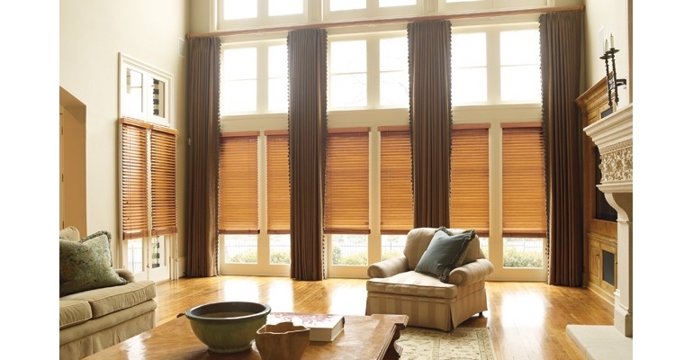 Orlando great room with wooden blinds and full-length draperies.