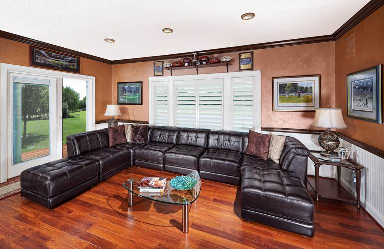 Orlando basement with slider doors and plantation shutters.
