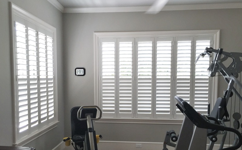 Orlando home gym with shuttered windows.