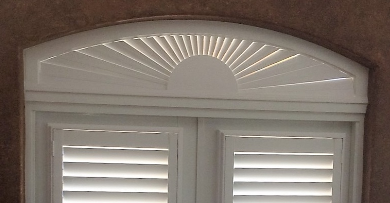 The best eyebrow window treatments sunburst shutters orlando for Should plantation shutters match trim