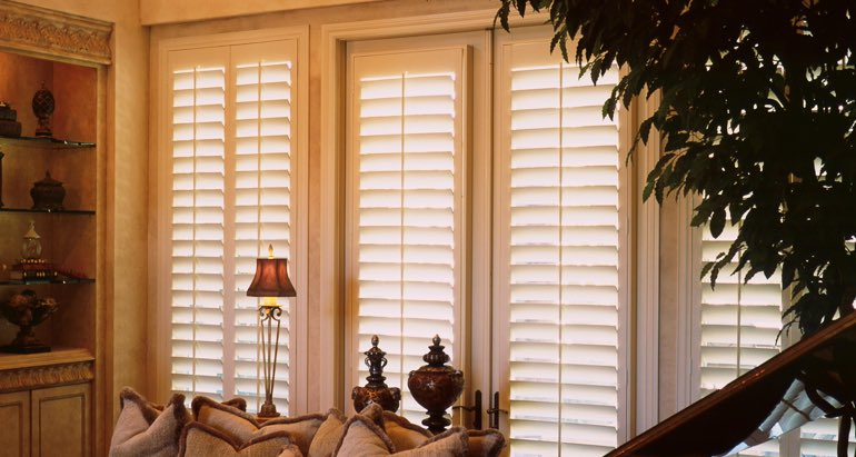 Plantation shutters on french door and window in Orlando lounge