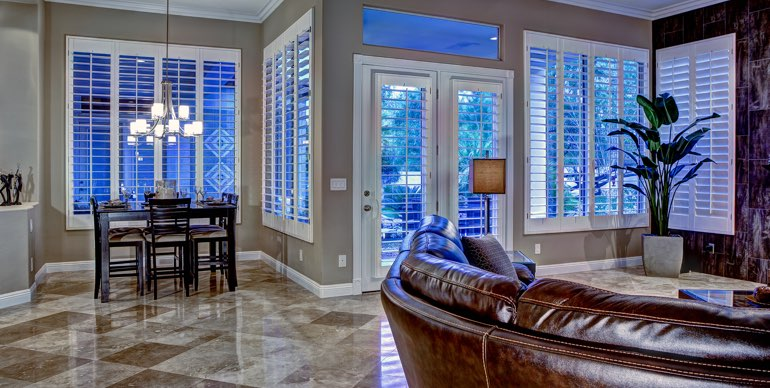 Orlando great room with white shutters and tile floor.