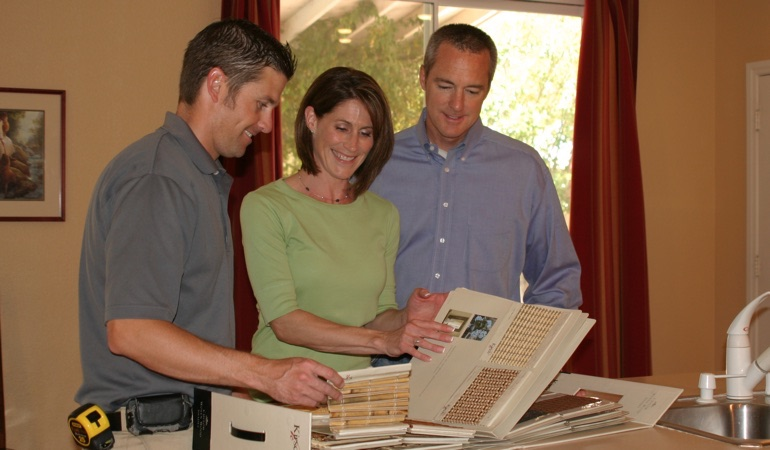 A couple viewing samples of window treatments.