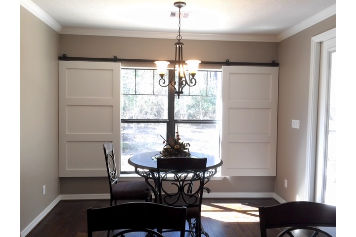 Orlando dining room with classic barn door shutters.