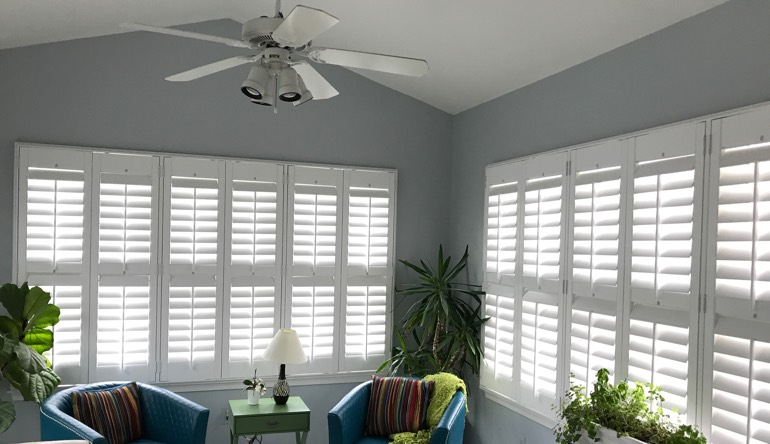 Orlando living room with fan and shutters
