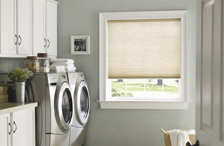 Orlando laundry room with beige window shades.