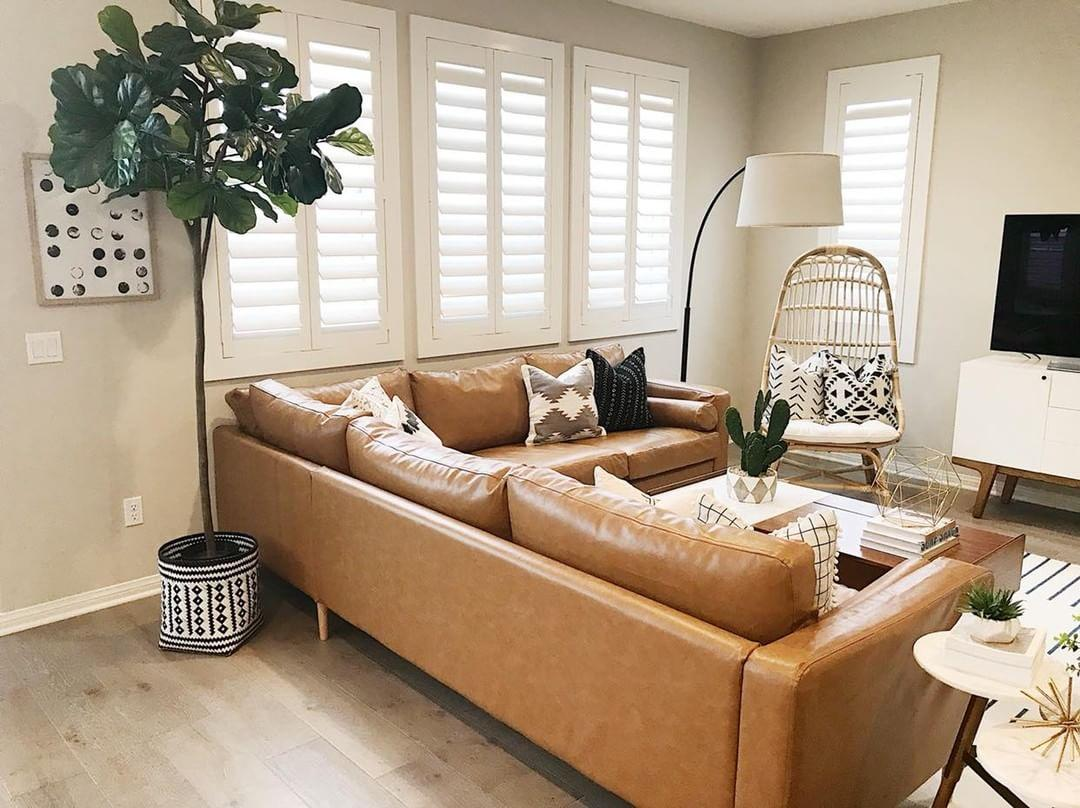 Warm living room with our Polywood shutters in Orlando.