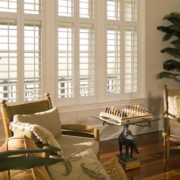 Orlando living room polywood shutters.