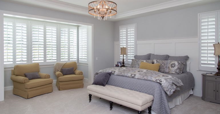 Interior shutters in Orlando bedroom.