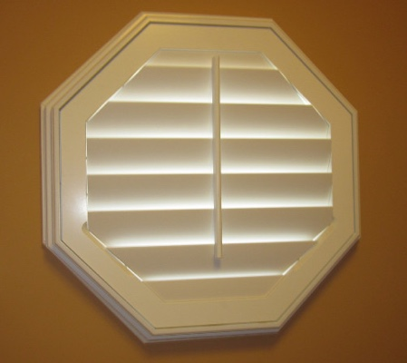 Orlando octagon window with white shutter