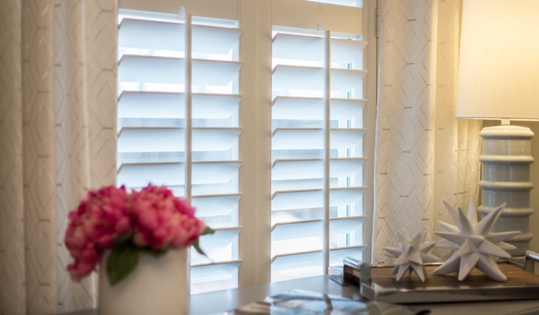 Plantation shutters by flowers in Orlando