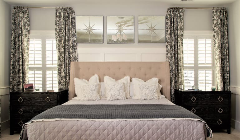 Plantation shutters in a bedroom.