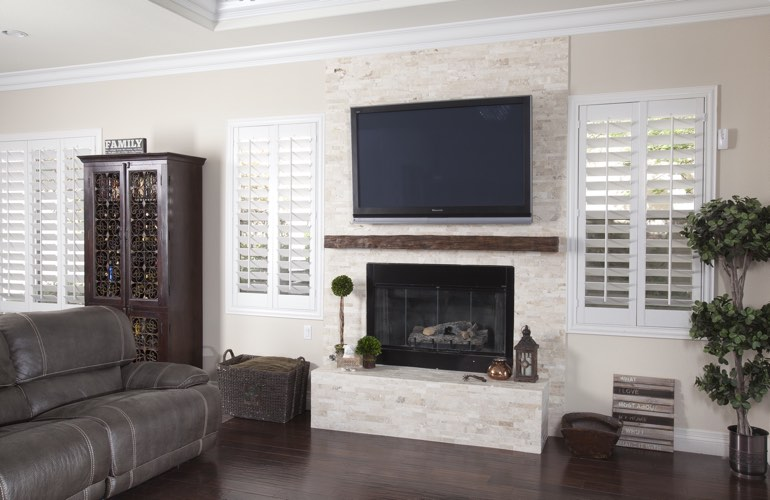 White plantation shutters in a Orlando living room with solid hardwood floors.