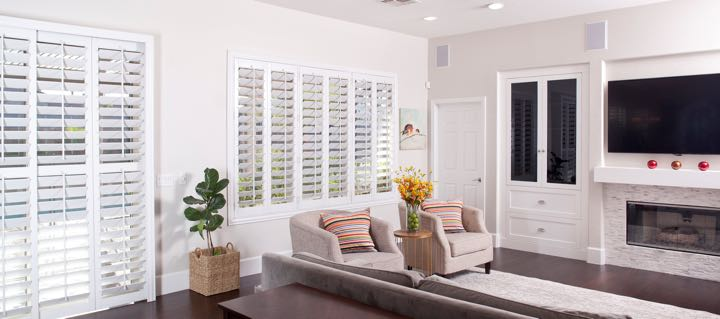 Orlando living room in white with plantation shutters.