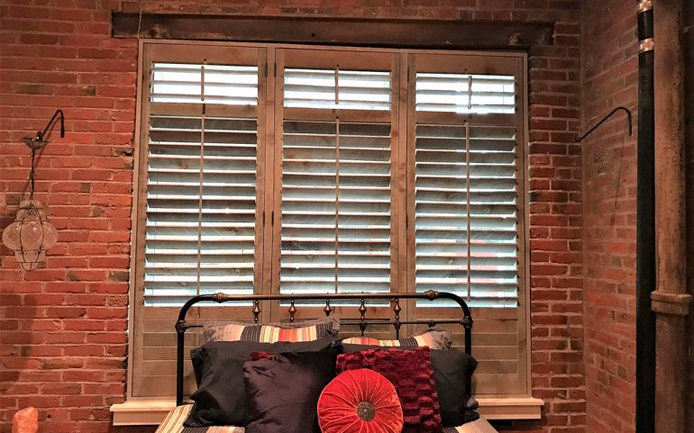 repurposed wood shutters in Orlando bedroom