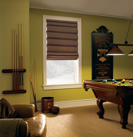 Roman shades in Orlando game room with green walls.