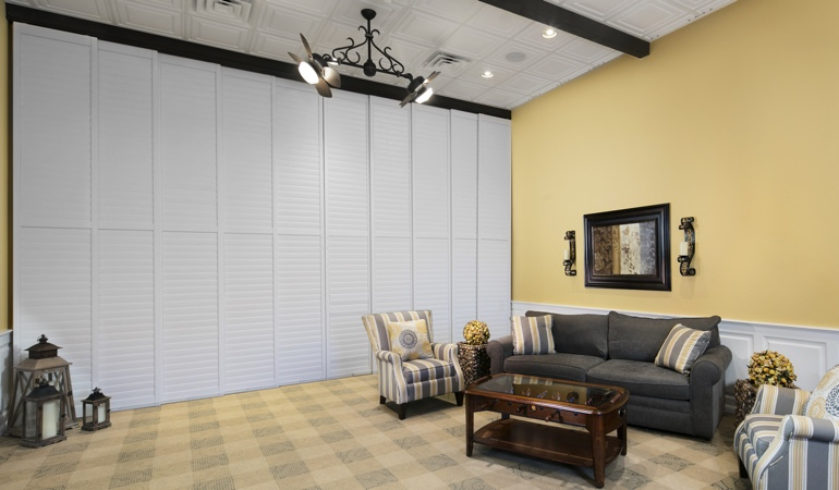 Plantation shutters as a room divider for a showroom