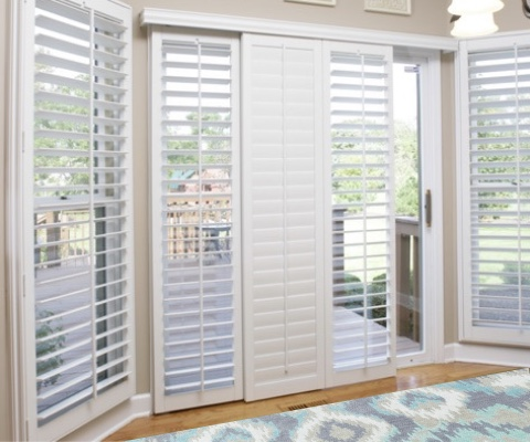 [Polywood|Plantation|Interior ]211] shutters on a sliding glass door in Orlando
