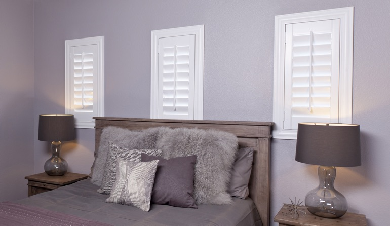 Classic plantation shutters in Orlando bedroom windows.