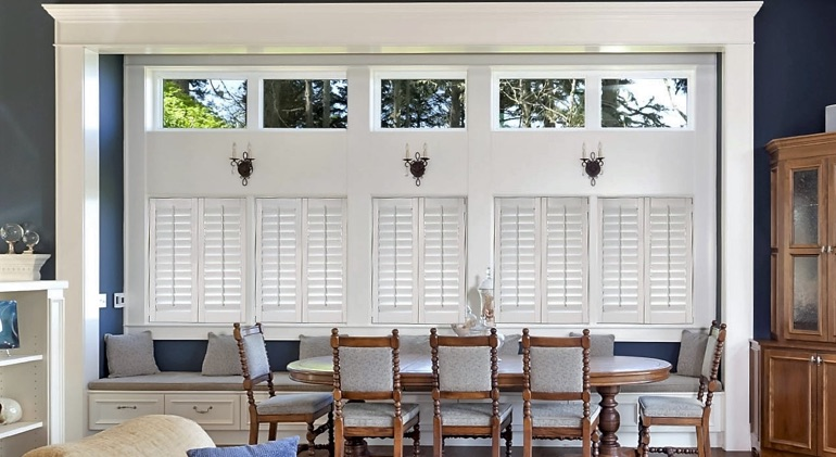Closed classic plantation shutters in Orlando dining room.