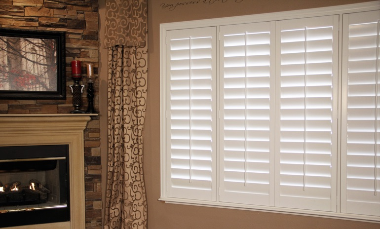 Orlando Studio plantation shutters in living room.