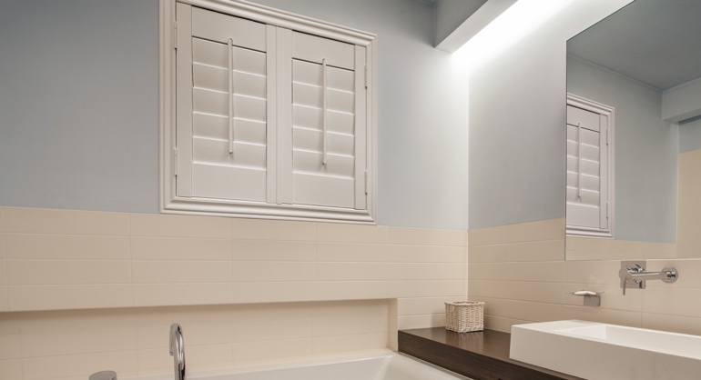 Plantation waterproof shutters in Orlando bathroom.
