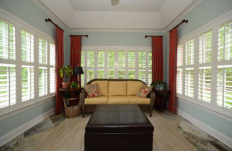 Orlando sunroom with classic window shutters.