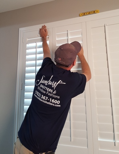 Shutter installation in Orlando bedroom.