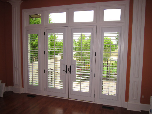 Orlando patio door with sidelight shutters