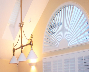 Orlando arched eyebrow window with white shutter