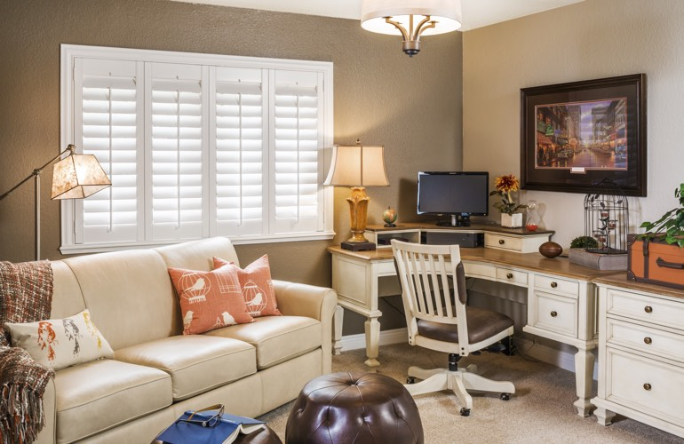 Orlando home office with plantation window shutters.