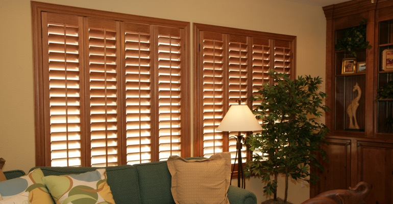 Hardwood shutters in Orlando living room.