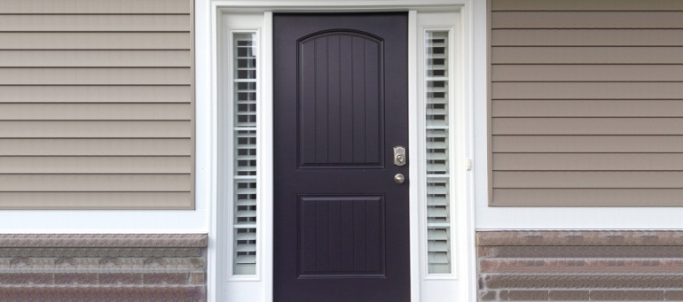 Entry Door Sidelight Shutters Next To Black Door In Orlando, FL