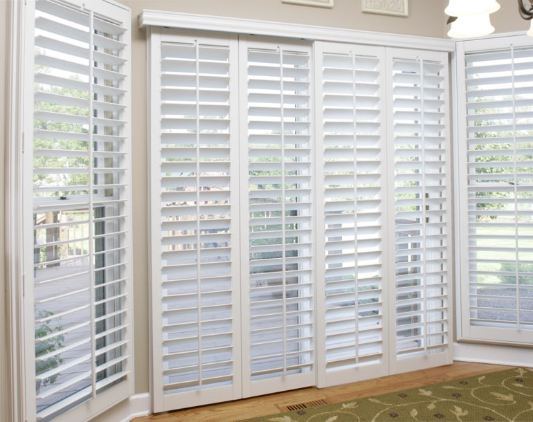 Sliding glass door with white shutters Orlando