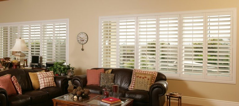 Wide window with plantation shutters in Orlando living room